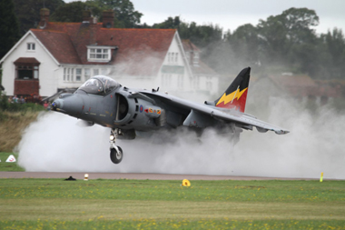 Harrier Jump Jet surrounded by spray at Shoreham Air Show 2010