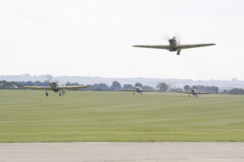 Four Hawker Hurricanes taking off at the Duxford Battle of Britain Air Show