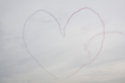 The Patrouille de France making a heart in the sky at Duxford The Battle of Britain Air Show