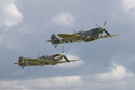 Supermarine Spitfire Mk Vb G-MKVB BM597 and Supermarine Spitfire Mk IX G-IXCC PL344 at Duxford Flying Legends 2009