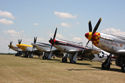 North American Aviation Mustangs in flightline walk at Duxford Flying Legends 2010