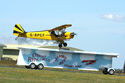 O Briens Flying Circus Aerobatic Stunt Team Piper Cub landing on a moving trailer at Kemble Air Show 2010