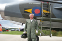 Squadron Leader Dennis Brooks standing in front of English Electric Lightning XS904/BQ at the 50th anniversary of the Lightning into service and the unveiling of the Lightning Q shed