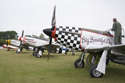 Three Mustangs in flightline walk at the East Kirkby RAFBF Air Show 2010