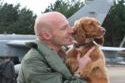 Flight Lieutenant Steve Morris and Jezebel the Spaniel at the RAF Tornados return from the Libya operations event