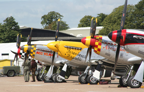 North American Aviation P-51 Mustang props in flightline walk at Duxford Flying Legends Air Show 2009